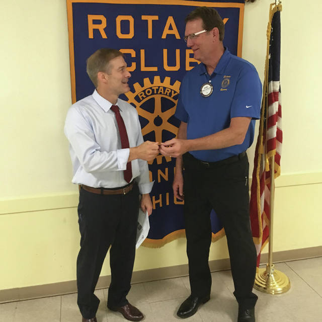 Sidney Rotary President Wayne Thompson presents a Sidney Rotary Four-Way Test Coin to Fourth District Congressman Jim Jordan at the conclusion of his remarks at a recent meeting.