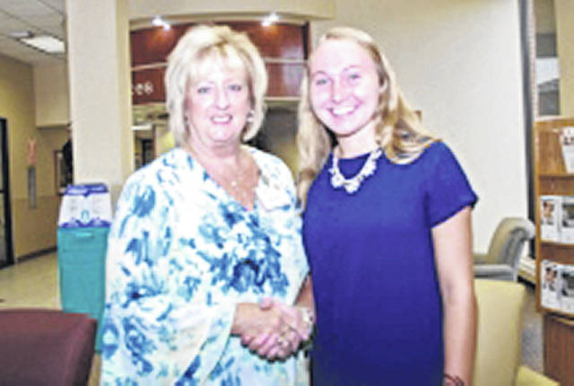 Carrie Fesenmyer, right, of New Bremen, received a $1,000 Landen Phlipot Nursing Scholarship. She is pictured with JTD Hospital Foundation Executive Director Linda Haines.