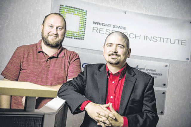 Pictured are John Owen, a Wright State Research Institute program manager, and Paul Jackson, the Wright State Research Institute's director of commercialization and entrepreneurship. The Wright State Applied Research Corp. and its partners were awarded a $750,000 federal grant to spur economic development.