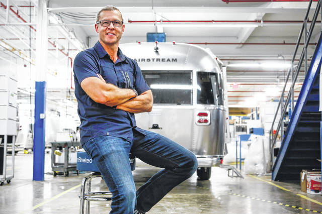 Bob Wheeler, president and CEO of Airstream, Inc., sits in front of an Airstream travel trailer. Airstream will be featured at the Made in America Product Showcase on July 15.