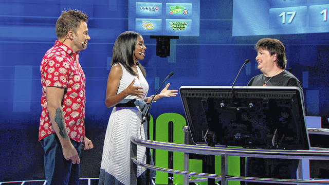 "Jackson Center resident Tina Sailor, right, talks to hosts David McCreary and Alissa Henry during Saturday'sepisode of the Ohio Lottery television show ""Cash Explosion."""