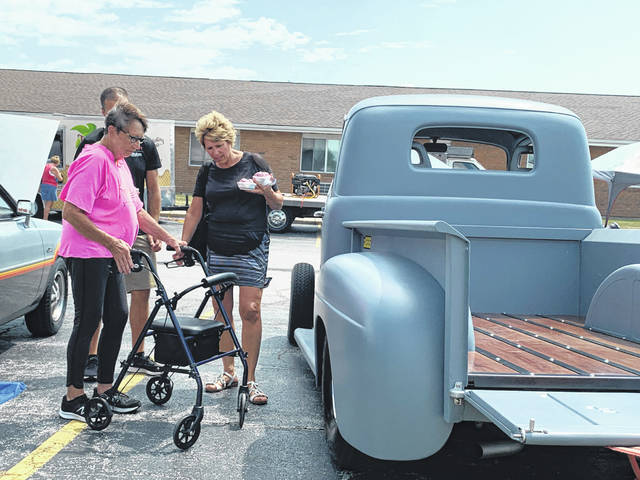 Versailles Rehab & Healthcare Center resident Mary Schellhaas and her daughter-in-law Christine Schellhaas look at a truck during the Community Food Truck Rally & Cruise-In.