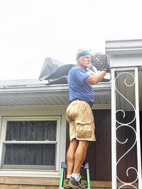 "Pastor Randy Locker is on the job helping to replace a roof during his churches' ""Love 1 More"" campaign."