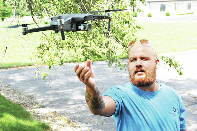 Devin Brautigam displays his new and improved drone that now has infrared dog tracking capabilities.