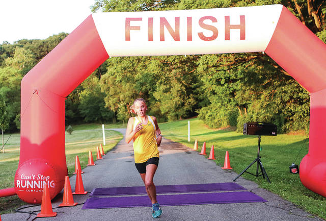 Brittany Arnold, 13, of Sidney, daughter of Tony and Jill Arnold, finishes first place in the New Choices 5K at Tawawa Park Thursday, July 18.