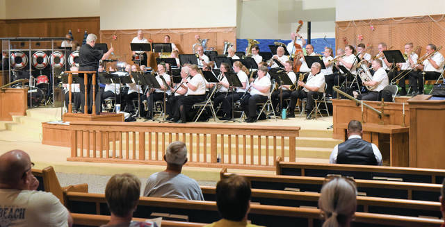 Philip Chilcote conducts the Sidney Civic Band at Connection Point Church of God on Friday, July 19. It was the final concert of the season.