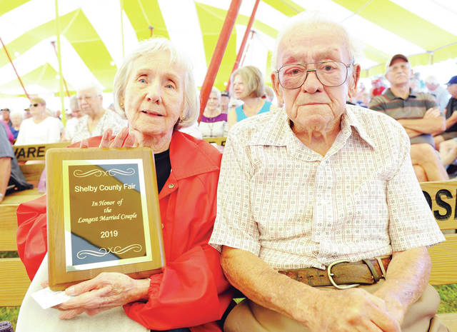 Norlene, left, and Bernard Cotterman, of Sidney, were declared the longest married couple at the Shelby County Fair during Senior Citizens Day at the fair Tuesday.
