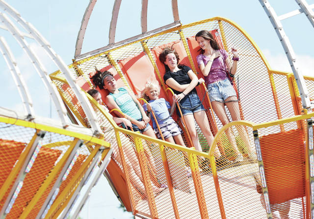 Riding the Scat 2 at the Shelby County Fair Tuesday, July 23 are, left to right, Liliana Phillips, 13, of Sidney, daughter of Sonya and Keith Phillips, and Miah Huelskamp, 12, of Sidney, daughter of Jessica Guillozet and Ed Huelskamp, Ally Reiss, 7, of Cincinnati, daughter of Krista and Andy Reiss, Grace Steenrod, 13, of Sidney, daughter of Sarah Steenrod and Ryan Work, and Kendall Inman, 14, of Sidney, daughter of Melissa and Craig Inman.