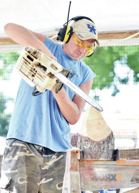 Tim Crager, of Garrett, Kentucky, performs some chainsaw carving at the Shelby County Fair on Tuesday, July 23.