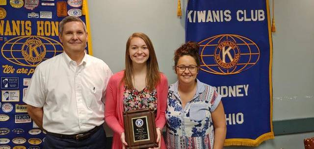 Samantha Gaerke, pictured with Kiwanis Secretary Mike Tangeman and President Jessica Guillozet, was honored by The Sidney Noon Kiwanis Club as the Teen of the Year.