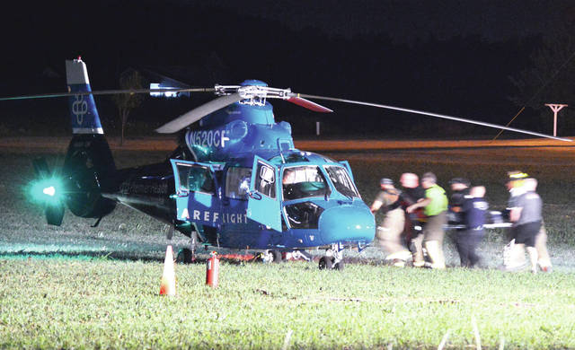 CareFlight prepares to transport one of the three women injured in a four-wheeler crash in the 17000 block of Sidney Freyburg Road at 9:37 p.m. Saturday, July 27.