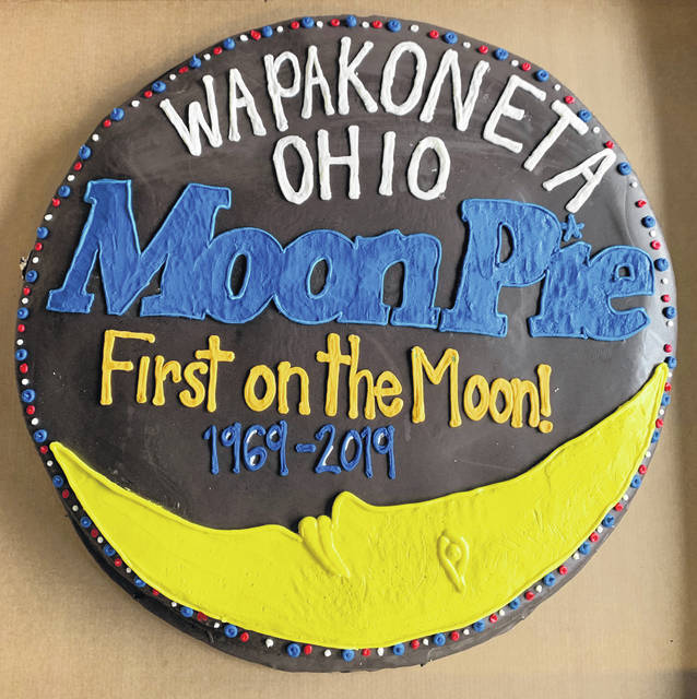 This MoonPie weighing 55 pounds, measuring 40-inches in diameter and 6-inch in height and boasting 14 pounds. of marshmallow, 6 pounds of chocolate and 45,000 gravity defying calories, will be served to all in attendance at the Wapakoneta Moonfest for as long as it lasts.