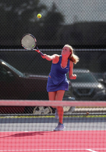 Lehman's Angela Brunner serves at first singles during a match on Wednesday in Troy. Brunner lost 6-0, 6-0.