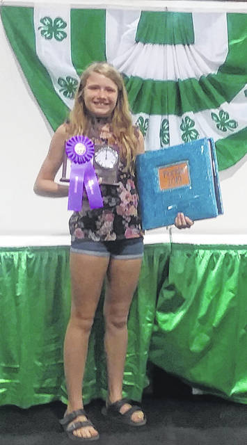 Ashley Gehret, 12, of Anna, won Outstanding of the Day and was Clock Trophy Winner for the 2019 Creative Arts Day Scrapbooking Junior Class at the State Fair. She is the daughter of Joyce Gehret and is a member of McCartyville Producers 4-H Club. -