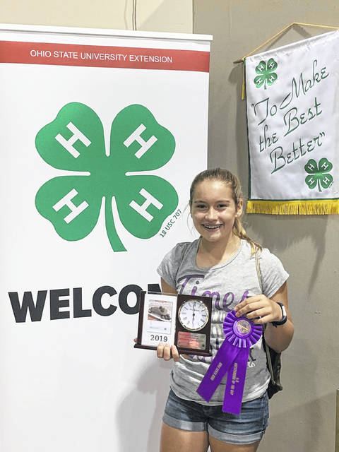 Avery Jackson, 12, won the clock trophy at the Ohio State Fair for food and nutrition in Let's Bake Quick Breads. She is the daughter of Anthony and Stephanie Jackson and her 4-H club is Creative Clovers of Shelby County in Jackson Center.