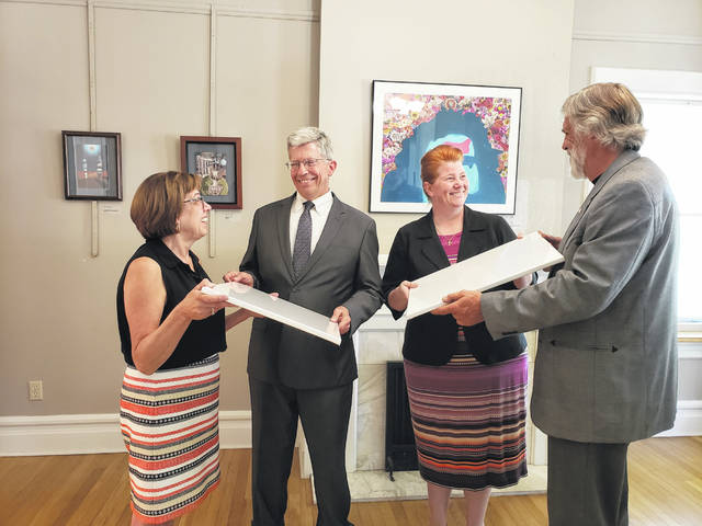 """Gateway Arts Council Executive Director Ellen Keyes, left to right, Bad Art by Good People participants Gary Carter and Rachel Hale, and GAC President Chris Gibbs discuss this year's program which will benefit Wilson Health's """"The Future is Clear"""" campaign."""