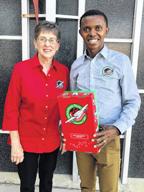 Bonnie Condry, left, is a local representative of Operation Christmas Child along with her husband, Mike. She is pictured with Alex Nsengimana, a former Operation Christmas Child recipient who escaped the 1994 Rwandan genocide.