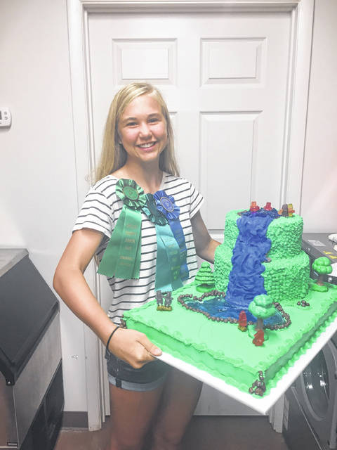 Brooke Holthaus, 15, daughter of John and Kelly Holthaus, of Fort Loramie, won outstanding of the day and was a state qualifier with her waterfall cake at the Shelby County Fair. She was competing in the senior beginner's class for cake decorating. She is a member of the Marry Mod Makers.