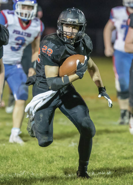 Minster's Alex Schmitmeyer runs during a Division VII, Region 28 playoff game against Riverside on Nov. 3, 2018 at Memorial Stadium in Minster. Schmitmeyer had 1,094 rushing yards and 20 rushing TDs last year.
