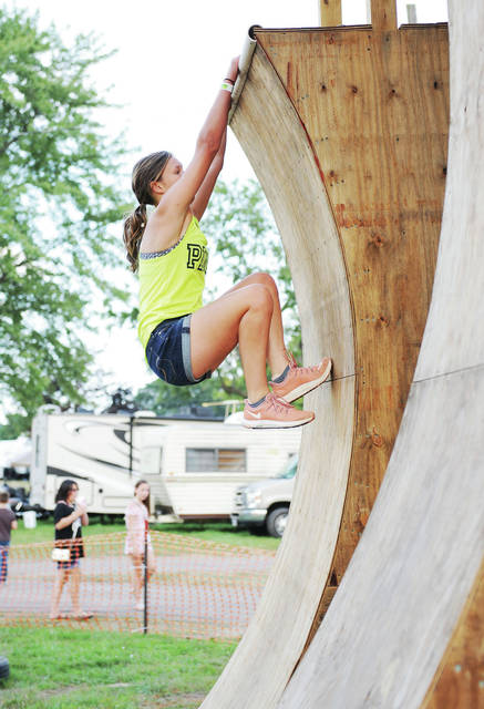Isabella Brown, 14, of Sidney, daughter of Terry and Shanna Heath, competes in the Ninja Warrior Competition at the Shelby County Fair.
