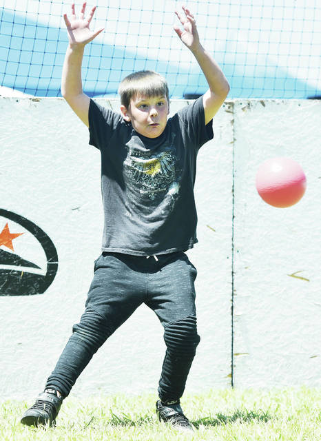 Jericho Hale, 10, of Sidney, son of Stefanie and Johnathan Hale, jumps aside to avoid getting hit during a game of dodgeball at Y-Fest on Saturday, Aug. 10.
