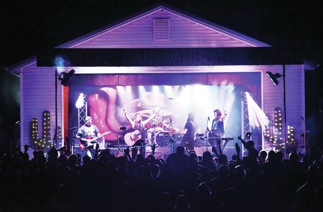 Kaitlyn Schmit and the Move perform at the annual White Oak Jamboree located just south of Fort Loramie, on Saturday, Aug. 10. This was the events 50th anniversary.