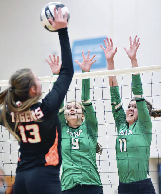 Anna's Madison Roe, left, and Macy Wiktorowski go for a block during a Shelby County Athletic League match against Jackson Center on Aug. 6, 2018 in Anna. Wiktorowski had 190 kills last season while Roe had 148.