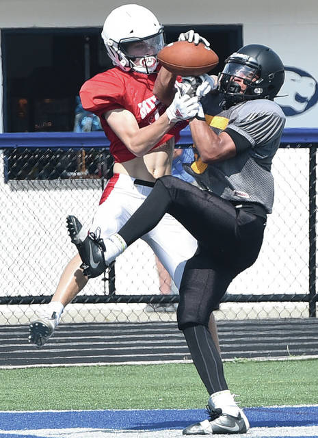 Sidney's Darren Taborn breaks up a pass to a Milford player during a quad scrimmage on Saturday at Edgewood Middle School in Trenton.