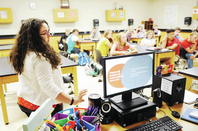Elizabeth Baker, of Minster, goes over class expectations for the year on the first day of school at Jackson Center Local Schools on Thursday, Aug. 15. It was Baker's first day teaching at Jackson Center Local Schools where she will be teaching high school science courses.