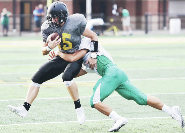 Sidney's Ryan Cagle is brought down on a run by a Chaminade-Julienne player during a scrimmage on Thursday at Sidney Memorial Stadium. Cagle is a three-year letterwinner and has started at linebacker each of the last two seasons. He will also see time at running back this year.
