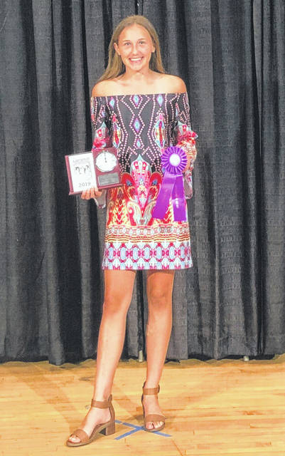 Eliza Gariety, 14, daughter of Greg and Connie Gariety, of Russia, won outstanding of the day and a clock trophy with her Look Great for Less 4-H project at the Ohio State Fair. She is a member of the Russia Fashionettes 4-H Club.
