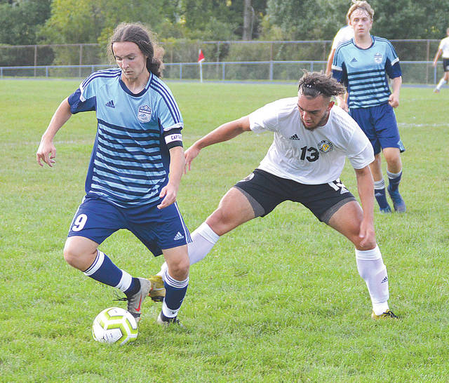 Fairborn defender Tyler Manning steals the ball from Sidney's Jalen Hudgins during a Miami Valley League boys soccer match on Tuesday in Fairborn. Sidney won 6-2 in its first MVL game.