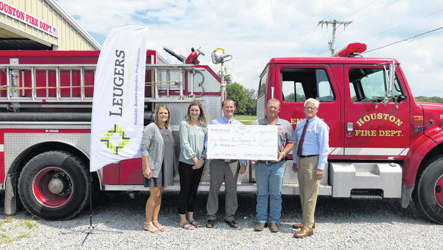 After being nominated by Leugers Insurance Agency, Houston Fire Department received a grant from Westfield Insurance Foundation to help upgrade equipment as part of the Westfield Legacy of Caring program. Pictured are Jacque Leverette, Sarah Bey, Scott Holthaus, all from Leugers Insurance Agency, Houston Fire Chief Jeff Poeppelman and Ted Bertke, of Leugers Insurance.