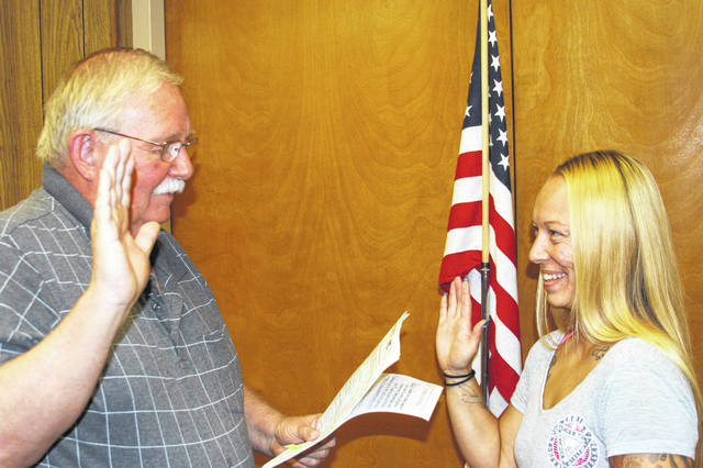 Mayor Steve Butterfield, left, swore in Dawn Hunkler as a member of the Port Jefferson Police Department during the Port Jefferson Village Council meeting on Monday.