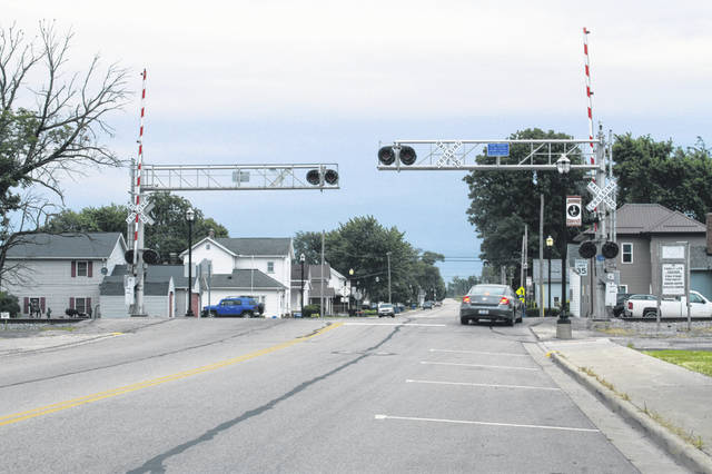 A passing motorist leaving town drives off the edge of the street onto the sidewalk area at the railroad crossing on state Route 274 in Jackson Center. The crossing was a point of discussion at the village council meeting Monday evening.