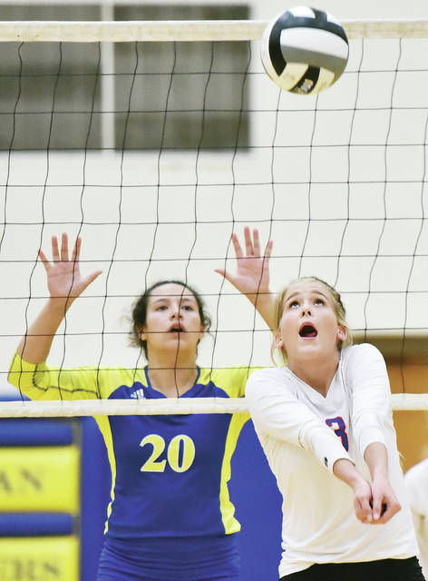 Riverside's Rachel Knight gets under the ball as Lehman Catholic's Lauren McFarland prepares to defend during a Northwest Central Conference match on Thursday in Sidney.