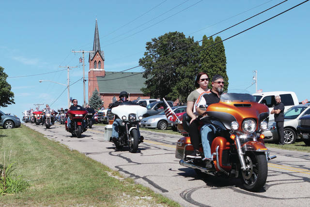 A line of motorcycle riders take part in the funeral escort of U.S. veteran Christopher Knouff at the Houston Congregational Christian Church in Houston on Saturday, Aug. 3. The Ohio Patriot Guard took part in the escort which too Knouff to Plattsville Cemetery where he was laid to rest with full military honors.