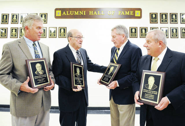 Attending the Lehman Catholic Hall of Fame on Saturday, Aug. 3 are, left to right, Dave Arbogast, of Cincinnati, who accepted his deceased father's induction, inductees David McBride, of Sidney, Dan Dunson, Cincinnati, and Dennis Sollmann, of Sidney.