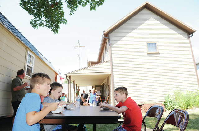 Eating ice cream at the Botkins Historical Society ice cream social and open house are, left to right, Hudson Meyer, 8, son of Brent and Julie Meyer, and Aaron Steinke, 9, both of Botkins, son of Jill and Artie Steinke, and Owen Motter, 10, of Wapakoneta, son of Rob and Stacy Motter. Visitors were able to see the results of renovations that have been completed over the last three years on the Shelby House Museum.