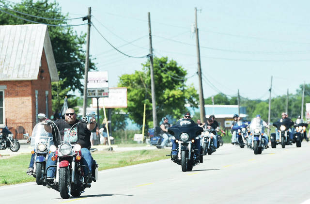 Bikers leave Sharp's Bar & Grill at 12 p.m. on Saturday, Aug. 10 to start the Wilson Health Hope Thru Hospice Ride. A D.J. played music as people gathered at Sharp's Bar & Grill and a moment for prayer. Later in the day there was a 50/50 and raffle baskets were given out. Proceeds will go to Wilson Health Hospice.
