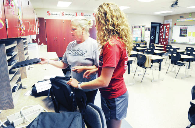 Fort Loramie Elementary 5th grade teacher Kelly Gephart, organizes Chrome Books for her students with the help of her daughter Kennedi Gephart, 17, both of Fort Loramie, on Wednesday, Aug. 14. Fort Loramie Elementary opens its doors to students on Tuesday, Aug. 20.