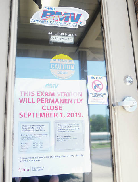 A sign on the Bureau of Motor Vehicles Sidney drivers exam office says it will close on Sept. 1.