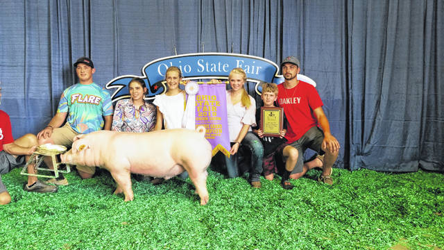 Sable Ruhenkamp, 14, won the Reserve Champion Chester hog at the Ohio State Fair. Pictured are, left to right, Jake Fogt, Summer Oaks, Sable Ruhenkamp, Iris Ruhenkamp, Bode Ruhenkamp and Frank Riethman. Sable is the daughter of Bryan and Kim Ruhenkamp, of Fort Loramie. She is a member of the Fort Loramie Livestock 4-H Club.