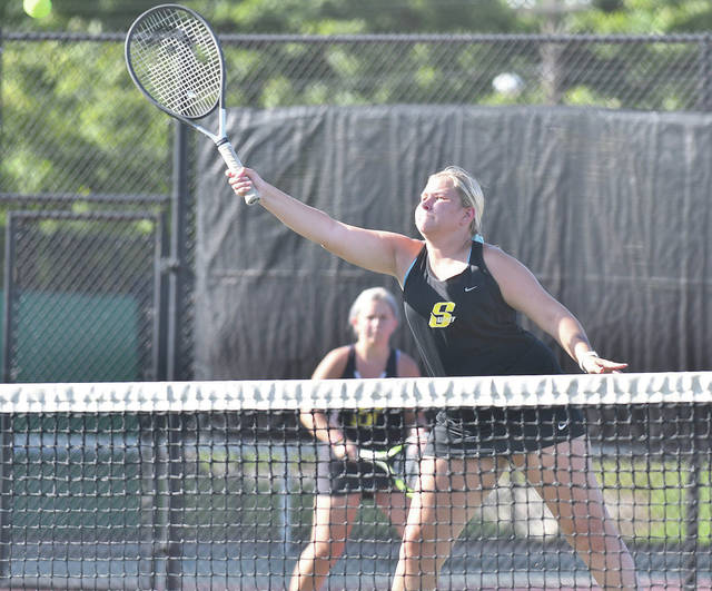 Sidney senior Ireland Ike makes a play at the net while playing at second doubles during a nonconference match against Milton-Union on Wednesday in West Milton. Ike and partner Avery Shreves have a 3-3 record.