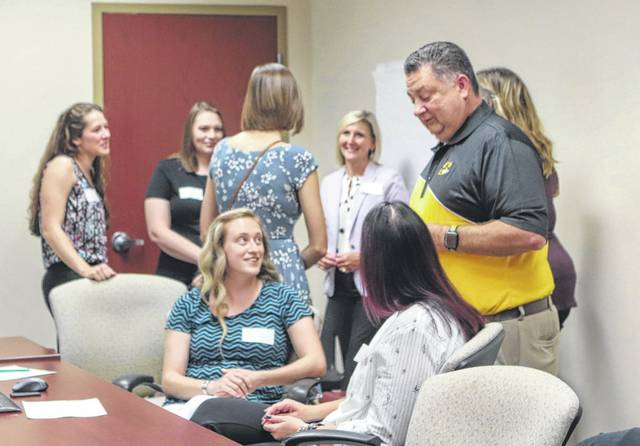 Sidney City Schools Superintendent Bob Humble visits with the district's new teachers during a reception held Monday afternoon, Aug. 19, at the board of education office.