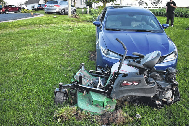 The blue Chrysler 2000, driven by Jessie L. Williams, 34, of Mendon, hit Mark Donald Ball, 65, of Upper Arlington, who was on the riding lawnmower in the yard of 2050 Fort Recovery Road, Houston. Williams went off the roadway when he failed to see the 90 degree curve in the roadway. Ball was transported by CareFlight to Miami Valley Hospital.