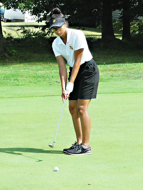 Sidney junior Cheyanne Bolden watches a putt during a Miami Valley League match against Piqua on Tuesday at Echo Hills Golf Course in Piqua. It was the first MVL event a Sidney team competed in.