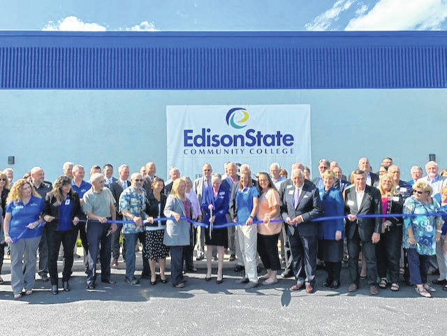 Dr. Doreen Larson, president of Edison State Community College, leads the ceremonial ribbon cutting for the college's new Troy location Wednesday afternoon while surrounded by trustees, staff, and members of the community. Located at 859 W. Market St., Edison State at Troy was established to meet the needs of the growing healthcare industry.