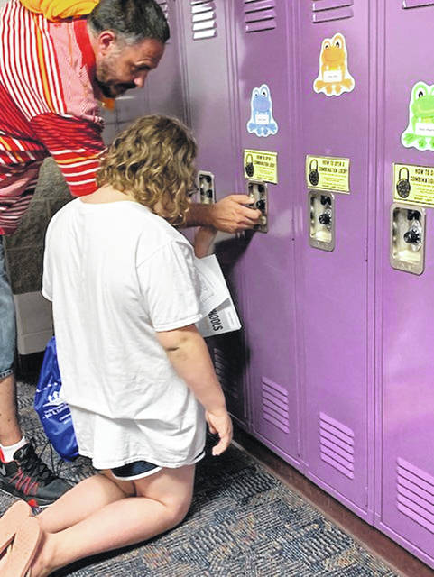 Gary Daniels helps his daughter, Raelyn Daniels, get her locker open during the open house at Sidney Middle School Monday, Aug. 27. Raelyn will be a fifth-grader at the school. Sidney City Schools students return to the classroom on Tuesday, Sept. 3.