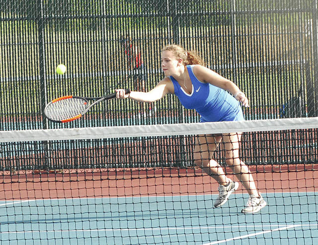 Lehman Catholic's Sophie McDonald stretches for the ball during a a doubles game in a match against Piqua on Wednesday in Piqua.